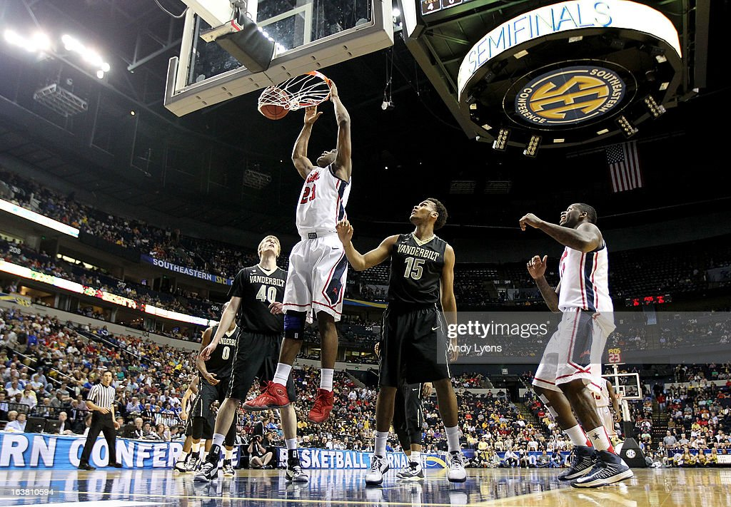 Reginald Buckner #23 of the Ole Miss Rebels shoots against <a gi-track='captionPersonalityLinkClicked' href=/galleries/search?phrase=Josh+Henderson+-+Basketball+Player&family=editorial&specificpeople=15212566 ng-click='$event.stopPropagation()'>Josh Henderson</a> #40 and Kevin Bright #15 of the Vanderbilt Commodores in the second half during the Semifinals of the SEC basketball tournament at Bridgestone Arena on March 16, 2013 in Nashville, Tennessee.
