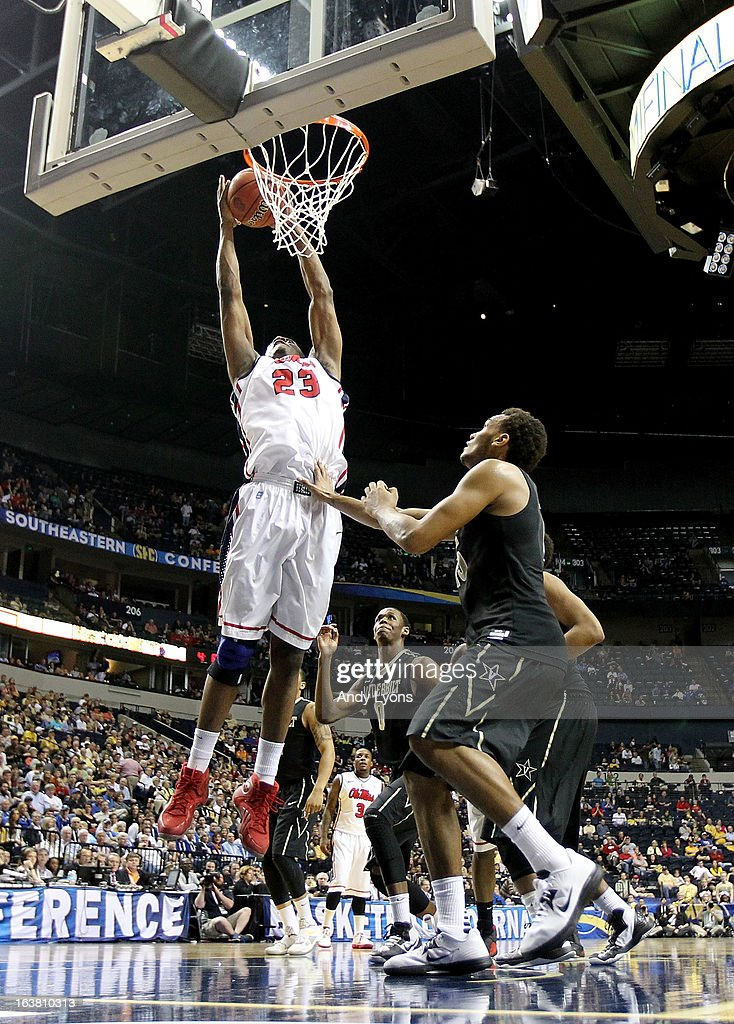 Reginald Buckner #23 of the Ole Miss Rebels shoots against Kevin Bright #15 of the Vanderbilt Commodores in the second half during the Semifinals of the SEC basketball tournament at Bridgestone Arena on March 16, 2013 in Nashville, Tennessee. Ole Miss won 64-52.