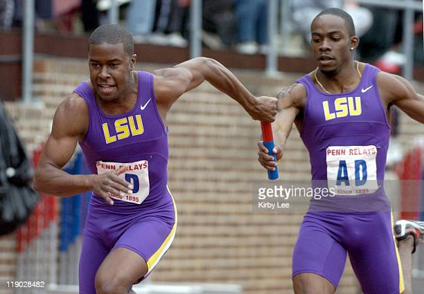 Reginald Dardar takes handoff from Kelly Wilie on the anchor of LSU heatwinning 4 x 200meter relay that ran 12425 in the 111th Penn Relays at...