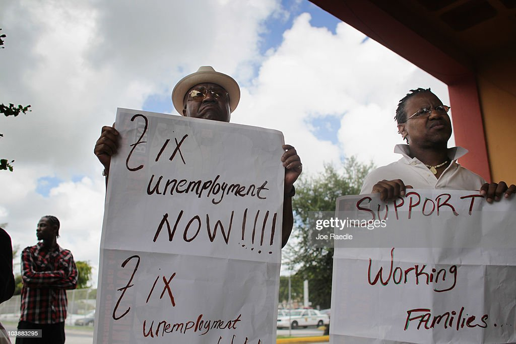 Reginald Munnings (L) and Will Brown attend a rally asking for Florida Governor Charlie Crist to sign an executive order for unemployment compensation reform on September 7, 2010 in Miami, Florida. Reginald Munnings who is attending the rally to show support and Will Brown who is unemployed are standing with those people struggling to find work with the unemployment rate in Florida staying around 11.5 percent. According to reports, Florida would be eligible for more than $400 million in federal stimulus money if the state modernizes its unemployment system.