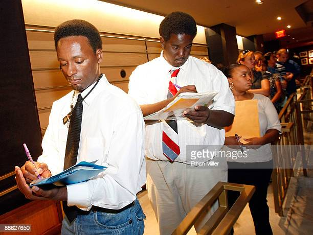 Reginald Swinton of Michigan and his friend Christopher Miller of Nevada fill out job applications during a twoday job fair at The Joint inside the...