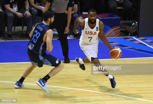 Reginald Williams II of United States fights for the ball with Patricio Garino of Argentina during the FIBA Americup final match between US and...