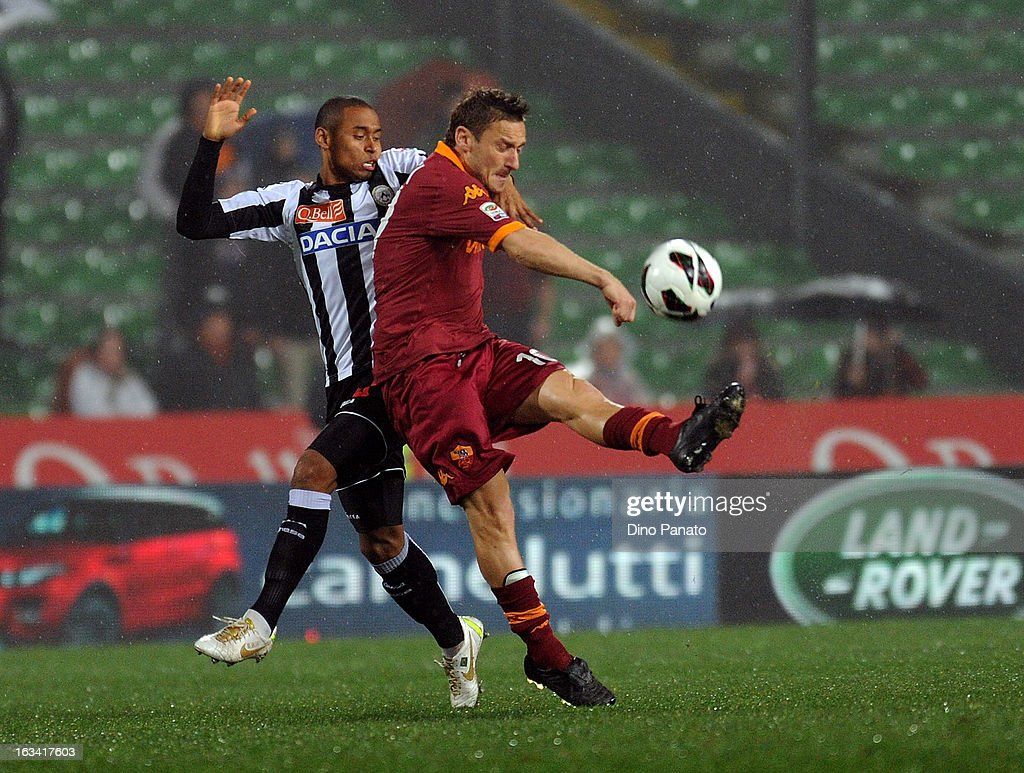 Reginaldo De Matos Maicosuel (L) of Udinese Calcio competes with <a gi-track='captionPersonalityLinkClicked' href=/galleries/search?phrase=Francesco+Totti&family=editorial&specificpeople=208985 ng-click='$event.stopPropagation()'>Francesco Totti</a> of AS Roma during the Serie A match between Udinese Calcio and AS Roma at Stadio Friuli on March 9, 2013 in Udine, Italy.