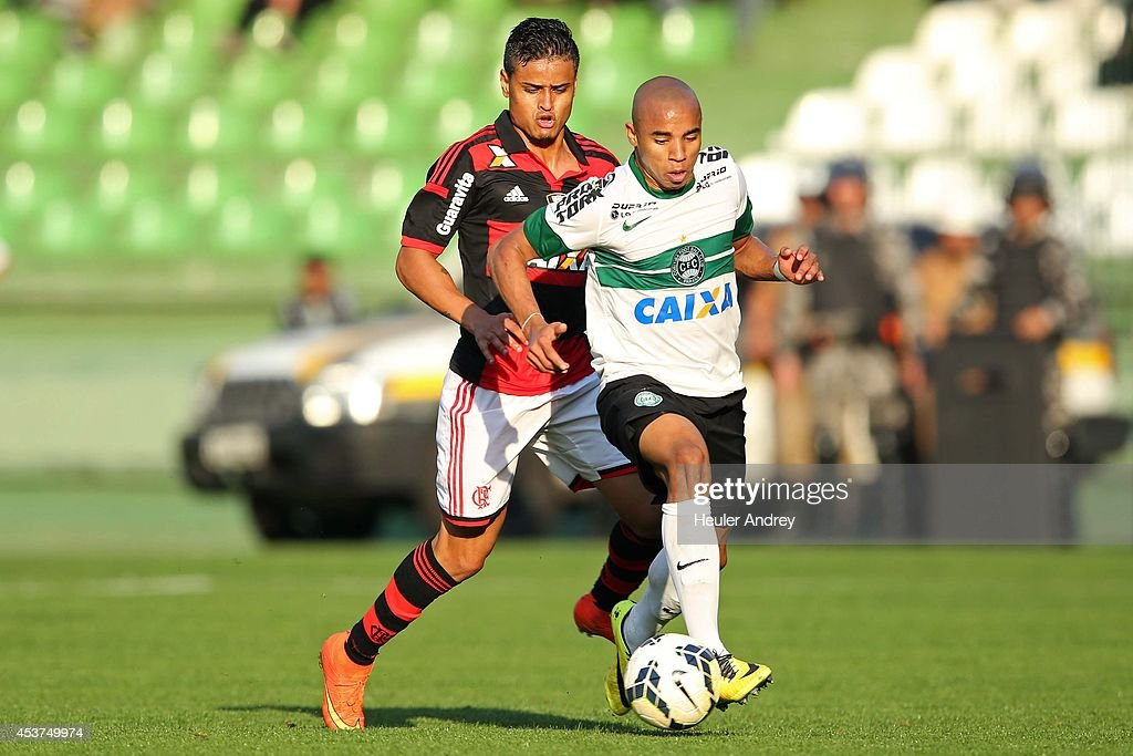 Reginaldo of Coritiba competes for the ball with Everton of Flamengo during the match between Coritiba and Flamengo for the Brazilian Series A 2014 at Couto Pereira stadium on August 17, 2014 in Curitiba, Brazil.