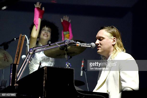 Regine Chassagne and Win Butler of Arcade Fire perform during the Voodoo Music Arts Experience at City Park on October 30 2016 in New Orleans...