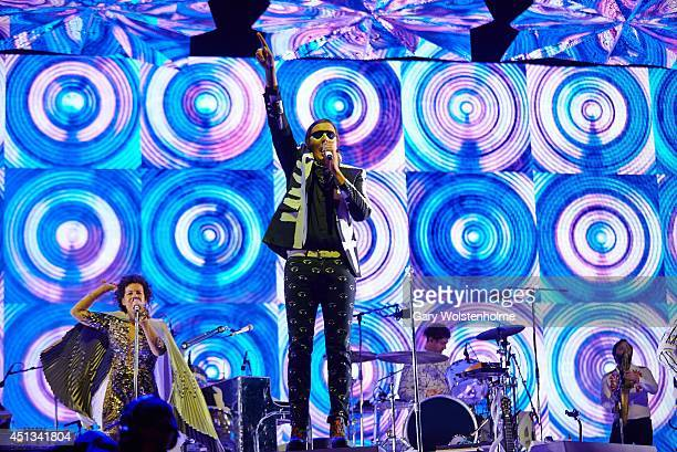 Regine Chassagne and Win Butler of Arcade Fire performs on Day 1 of the Glastonbury Festival at Worthy Farm on June 27 2014 in Glastonbury England