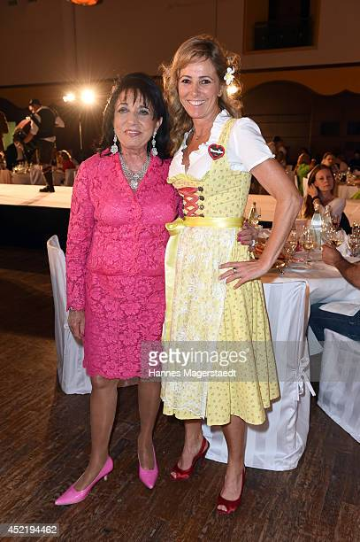 Regine Sixt and Gundis Zambo attend the Sixt ladies dirndl dinner on July 15 2014 in Munich Germany