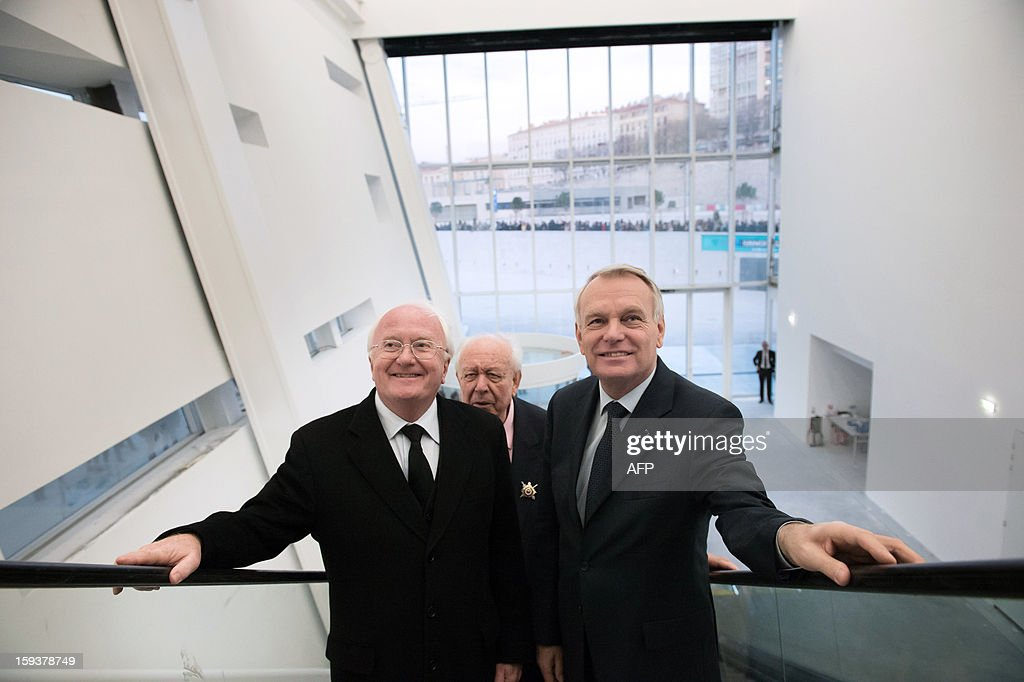 PACA region president Michel Vauzelle, Marseille's mayor Jean-Claude Gaudin and France's Prime Minister Jean-Marc Ayrault visit the 'Centre Regional de la Mediterranee' (Mediterranean Regional Centre) as part of the opening Ceremony of Marseille-Provence 2013 European Capital of Culture on January 12, 2013 in Marseille, southeastern France.