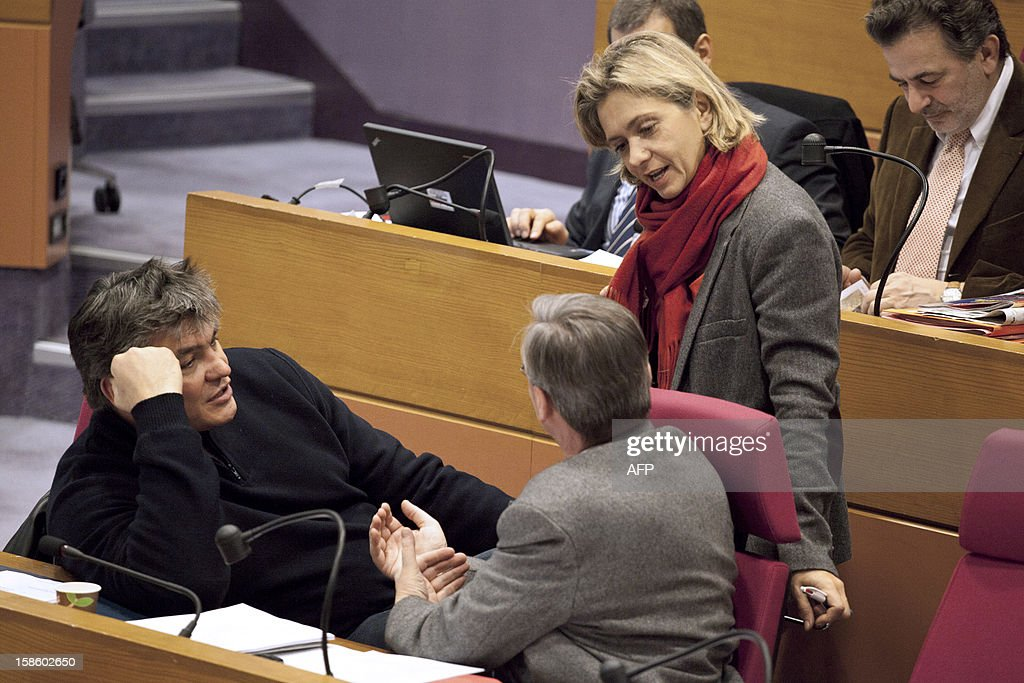 Regional advisers and former ministers Valerie Pecresse (R) and David Douillet (L) chat after a plenary session at the Regional Council of Ile-de-France on December 20, 2012 in Paris.