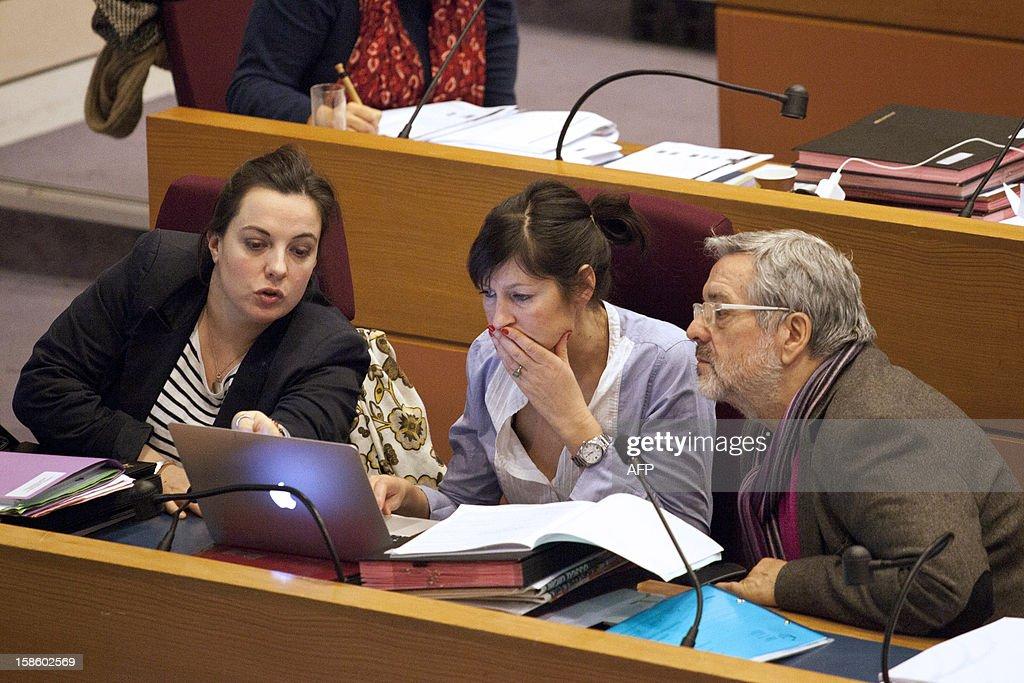 Regional advisers Emmanuelle Cosse (L), Laure Lechatellier (C) and Michel Bock attend a plenary session at the Regional Council of Ile-de-France on December 20, 2012 in Paris.