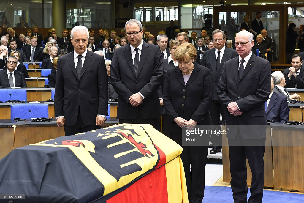 Regional chairman of the Saxony CDU Stanislaw Tillich, President of the Constitutional Court Andreas Vosskuhle, Chancellor <a gi-track='captionPersonalityLinkClicked' href=/galleries/search?phrase=Angela+Merkel&family=editorial&specificpeople=202161 ng-click='$event.stopPropagation()'>Angela Merkel</a> and President of the Bundestag <a gi-track='captionPersonalityLinkClicked' href=/galleries/search?phrase=Norbert+Lammert&family=editorial&specificpeople=575522 ng-click='$event.stopPropagation()'>Norbert Lammert</a> attend the state memorial ceremony to honor Hans-Dietrich Genscher at World Congress Center on April 17, 2016 in Bonn, Germany. Genscher, a member of the German Free Democrats (FDP), served as German foreign minister from 1974 to 1992 and was widely respected as a shrewd and successful diplomat through the end of the Cold War era.