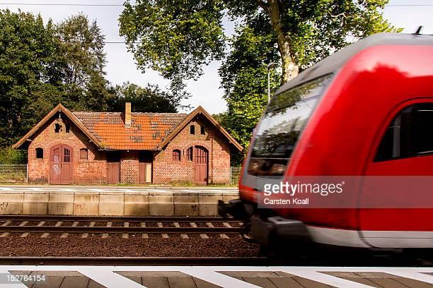 A regional commuter train of German railways carrier Deutsche Bahn arrives at main station on September 25 2012 in Hangelsberg Germany Deutsche Bahn...