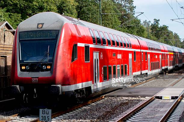 A regional commuter train of German railways carrier Deutsche Bahn arrives at main station on September 25 2012 in Fangschleuse Germany Deutsche Bahn...