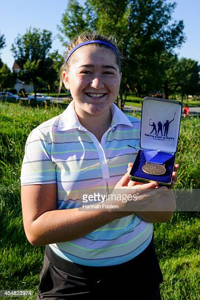 Regional Finals Girls 1415 overall champion Emily Lauterbach poses for a portrait after receiving her medal at the Drive Chip and Putt competition on...
