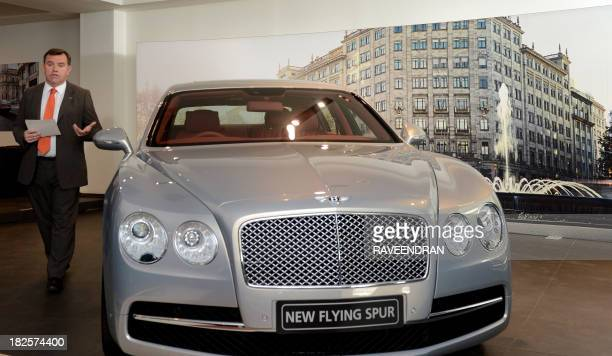 Regional Manager India South Africa and Middle East Chris Buxton poses with Bentley's Flying Spur car during the launch in New Delhi on October 1...