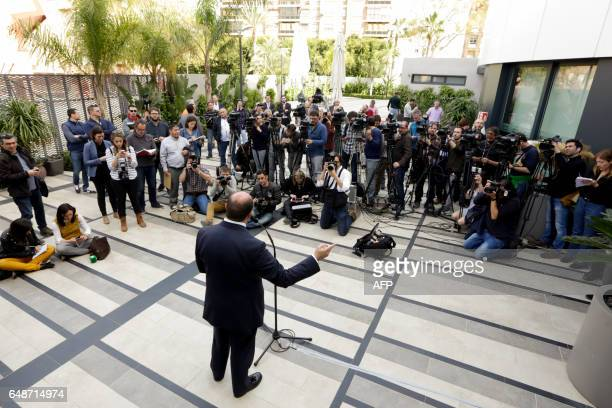 Regional president of Murcia conservative Pedro Antonio Sanchez speaks to journalists after a hearing at the court of Murcia on March 6 2017 / AFP...