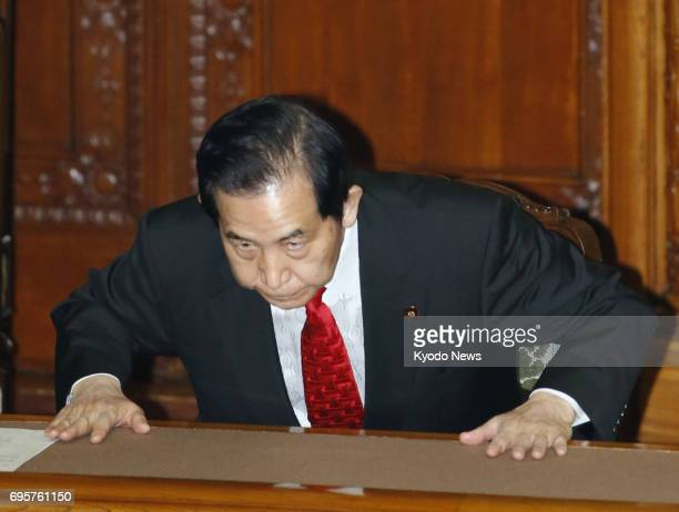 Regional revitalization minister Kozo Yamamoto bows in appreciation after a censure motion against him was voted down in the upper house in Tokyo on...