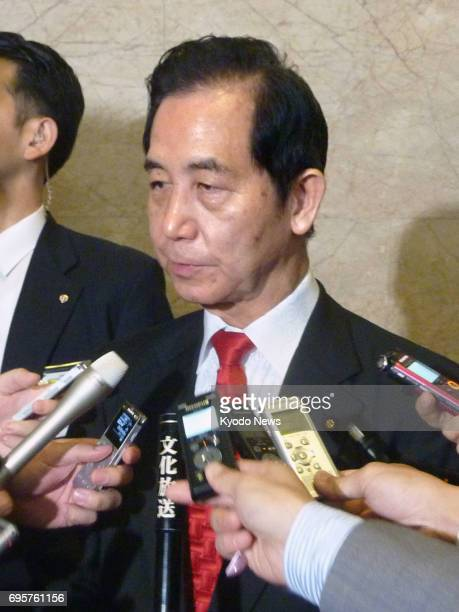 Regional revitalization minister Kozo Yamamoto meets with reporters at the Diet building in Tokyo after a censure motion against him was voted down...