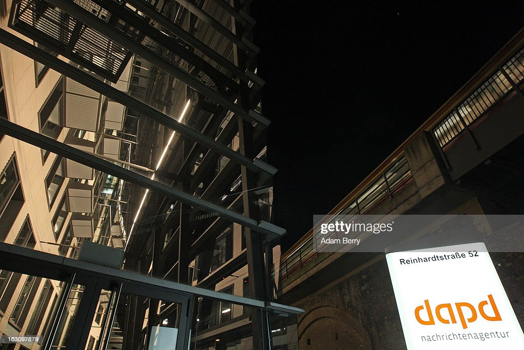 A regional (S-Bahn) train passes above the offices of the German news agency dapd on March 4, 2013 in Berlin, Germany. The country's second-largest news agency, dapd, was forced to declare insolvency for the second time in five months on March 1.