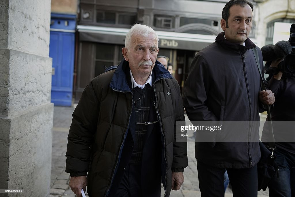 Regis de Camaret (L), former tennis coach who appears for rapes on two under-age women, 20 years ago, leaves the Lyon's courthouse flanked by his lawyer Emmanuel Daoud on November 15, 2012 during his trial.