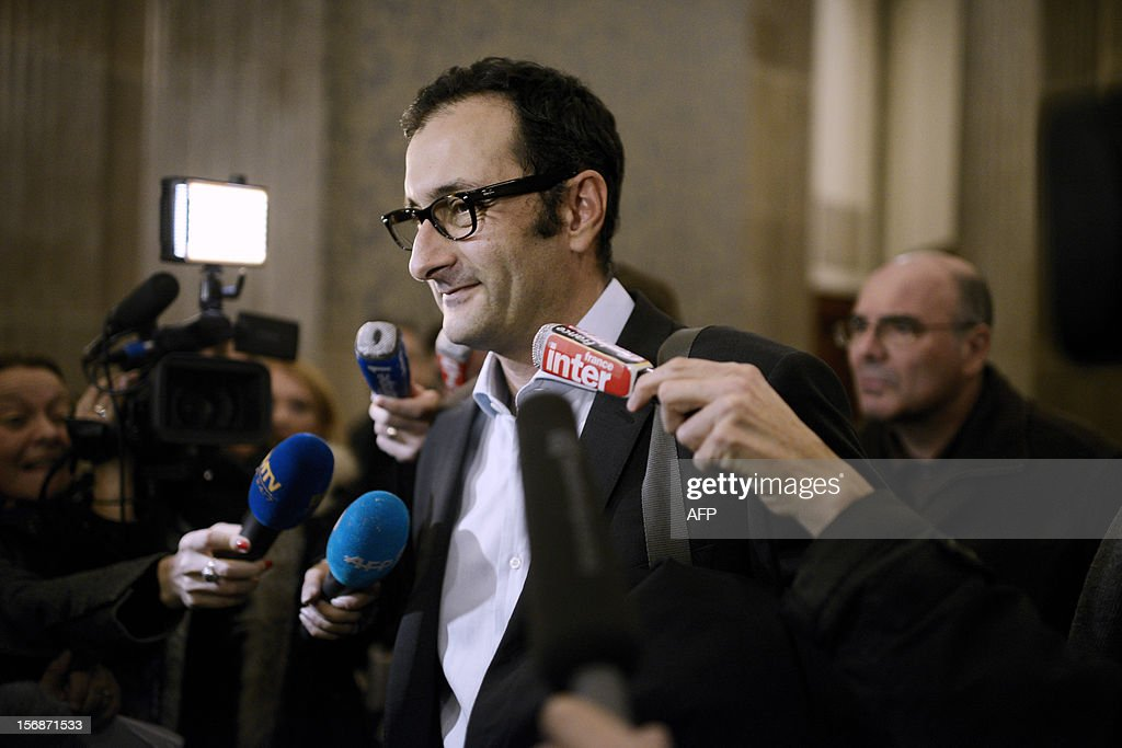 Regis de Camaret's lawyer, Emmanuel Daoud, is questioned by journalists as he leaves the courtroom, on November 23, 2012, at the courthouse in Lyon, after Camaret, a former tennis coach was condemned to 8 years in jail for rape on two under-age women, 20 years ago. AFP PHOTO / JEFF PACHOUD