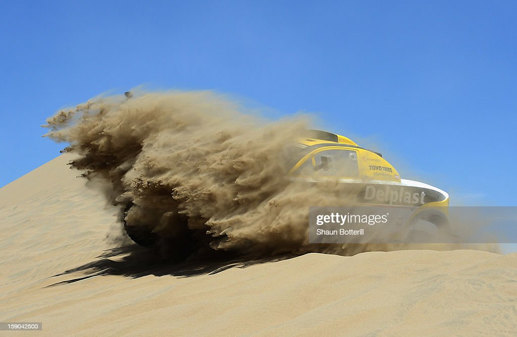 Regis Delahaye and co-pilot Alexandre Winocq of team Buggy MD Rallye compete during the stage from Pisco to Pisco on day two of the 2013 Dakar Rally on January 6, 2013 in Pisco, Peru.