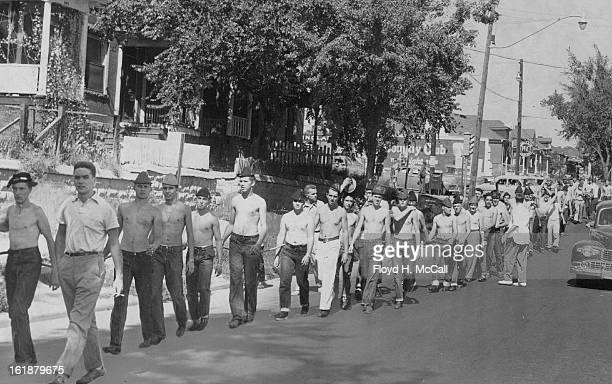 SEP 27 1952 SEP 28 1952 Regis Frosh Troop SouthA I ine of fifty Regis college freshmen all tied together in chain gang fashion troop south along...