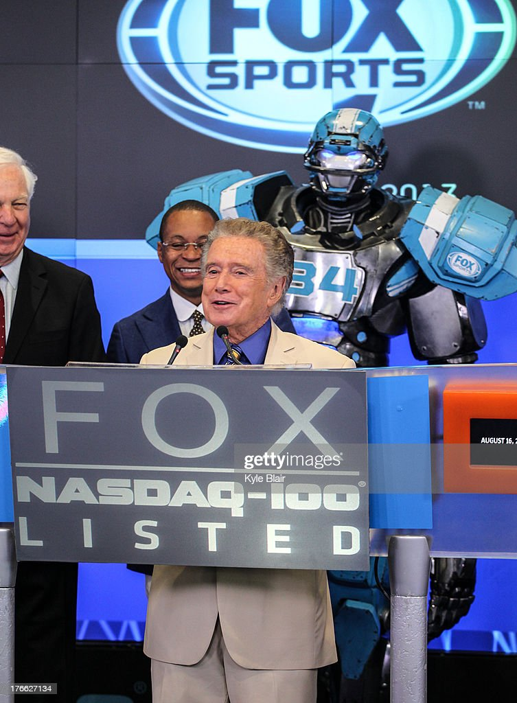 <a gi-track='captionPersonalityLinkClicked' href=/galleries/search?phrase=Regis+Philbin&family=editorial&specificpeople=202495 ng-click='$event.stopPropagation()'>Regis Philbin</a>; Cleatus The Robot ring the opening bell at the NASDAQ MarketSite on August 16, 2013 in New York City.