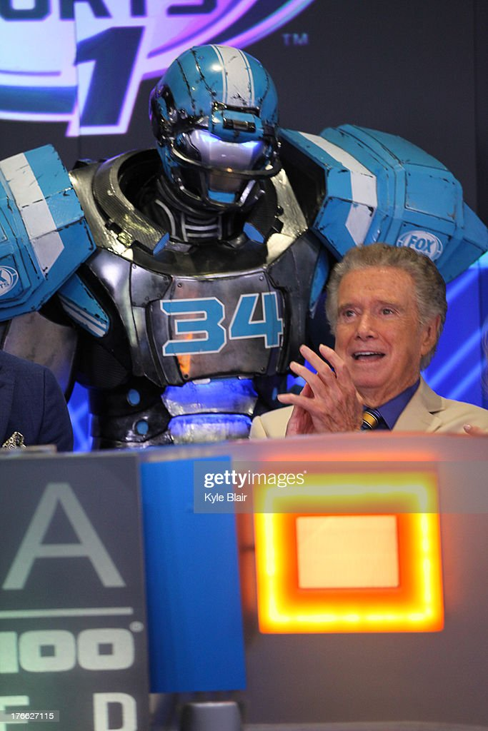<a gi-track='captionPersonalityLinkClicked' href=/galleries/search?phrase=Regis+Philbin&family=editorial&specificpeople=202495 ng-click='$event.stopPropagation()'>Regis Philbin</a>; Cleatus The Robot rings the opening bell at the NASDAQ MarketSite on August 16, 2013 in New York City.