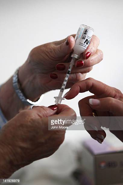 Registered nurse Susan Eager teaches a diabetic patient how to draw her own insulin injections during a house call on March 26 2012 in Denver...