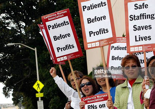 Registered nurses carry signs as they demonstrate outside of St Lukes hospital October 10 2007 in San Francisco California An estimated 5000...