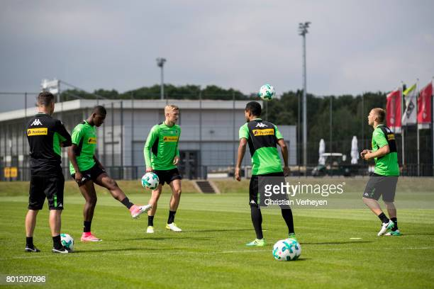 Rehab Coach Andreas Bluhm Mamadou Doucoure Marvin Schulz Raffael and Tony Jantschke during a training session of Borussia Moenchengladbach at...