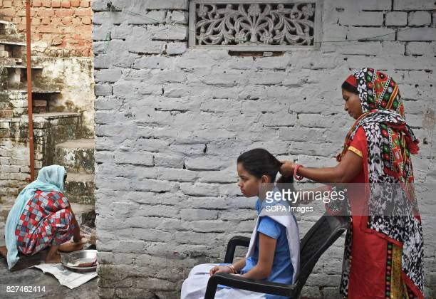 ALWAR RAJASTHAN ALWAR RAJASTHAN INDIA Rehabilitated manual scavenger Laxmi Nanda gets her daughter ready for school in her house According to United...