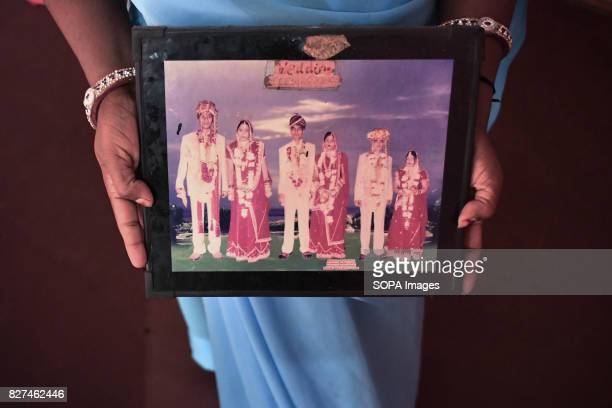 ALWAR RAJASTHAN ALWAR RAJASTHAN INDIA Rehabilitated manual scavenger Maya Sangeliya holds a picture showing the marriage of her three daughters...