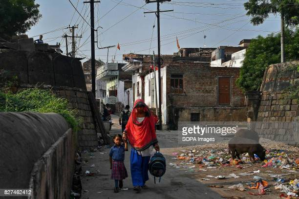 ALWAR RAJASTHAN ALWAR RAJASTHAN INDIA A rehabilitated manual scavenger takes her daughter to school before reporting for work at the Nai Disha rehab...