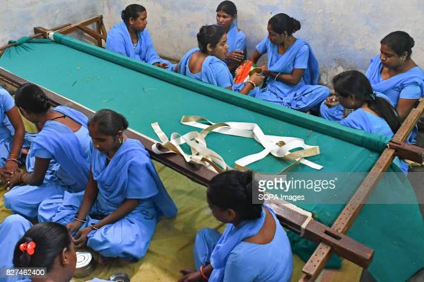 ALWAR RAJASTHAN ALWAR RAJASTHAN INDIA Rehabilitated manual scavengers breaks for lunch inside a room where they learn to work on embroidery inside a...