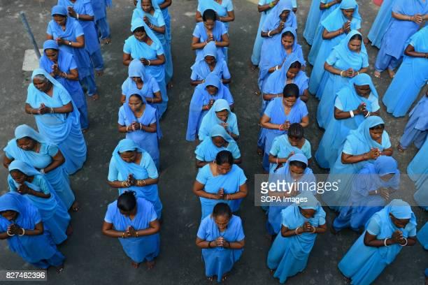 ALWAR RAJASTHAN ALWAR RAJASTHAN INDIA Rehabilitated manual scavengers gather for assembly and prayer inside a rehabilitation center called Nai Disha...