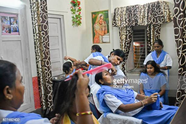 Rehabilitated manual scavengers learn and practice beauty treatment techniques inside a rehabilitation center called Nai Disha run by an NGO...