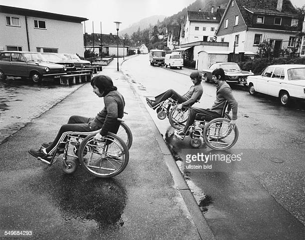 Rehabilitation Centre for paraplegic patients in Wildbad in South West Germany young men in wheelchairs on a street