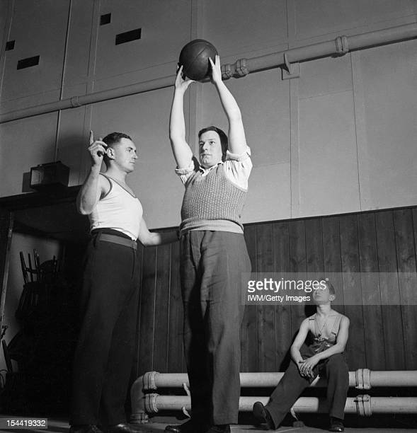 The Work Of Queen Mary's Hospital Roehampton London England UK Mr Allen Theobald receives Physical Training instruction from Sergeant Major Allen at...
