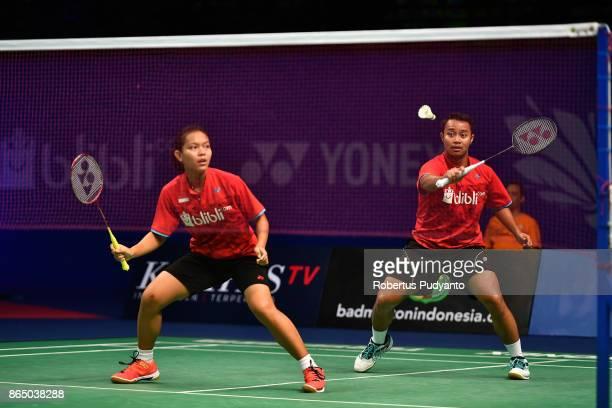 Rehan Naufal Kusharjanto and Siti Fadia Silva Ramadhanti of Indonesia compete against Rinov Rivaldy and Pitha Haningtyas Mentari of Indonesia during...