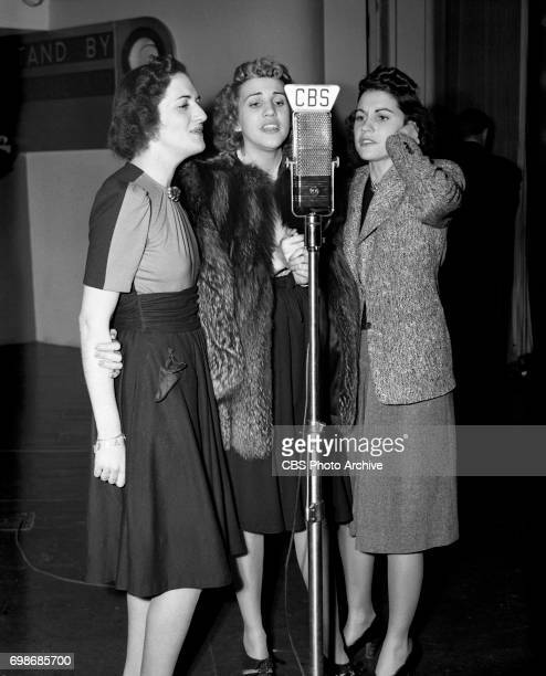 Rehearsal for CBS Radio program Chesterfield Time featuring the Andrews Sisters from left LaVerne Patty and Maxene Andrews Image dated December 27...