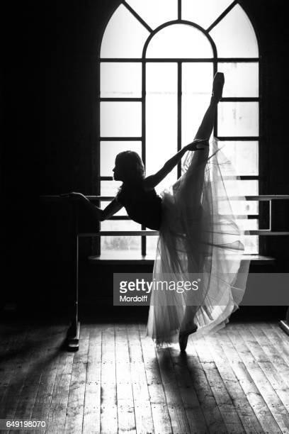 Rehearsing Ballerina. Silhouette Near Choreographic Machine