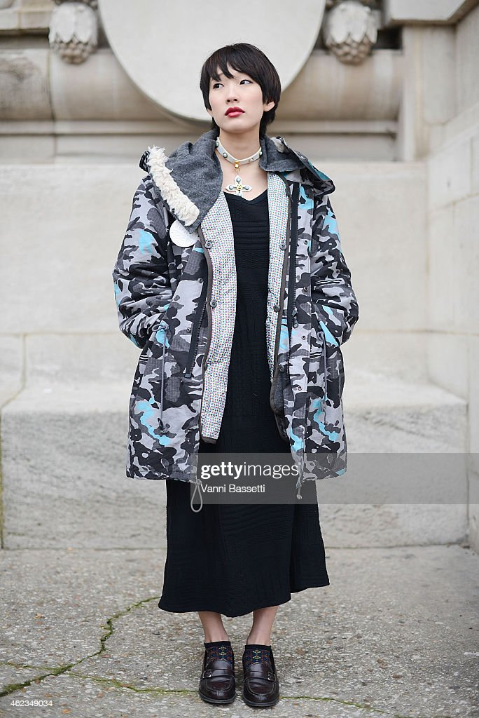Rei Abe poses wearing a Anrealage parka during day 3 of Paris Haute Couture Spring Summer 2015 on January 27 2015 in Paris France