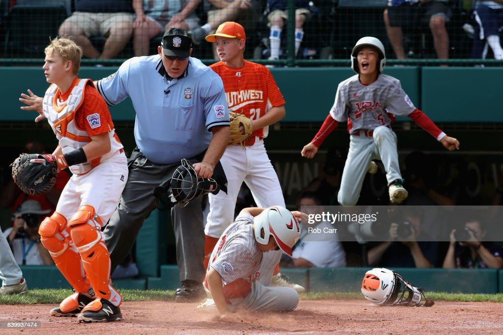 Rei Ichisawa #7 of Japan scores a second inning run in front of catcher Chandler Spencer #19 of the Southwest Team from Texas during the Champioinship Game of the Little League World Series at Lamade Stadium on August 27, 2017 in South Williamsport, Pennsylvania.