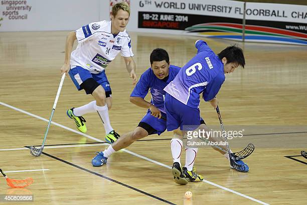 Rei Oshima of Japan helps out in defense during the World University Championship Floorball match between Japan and Finland at the Sports Hub OCBC...
