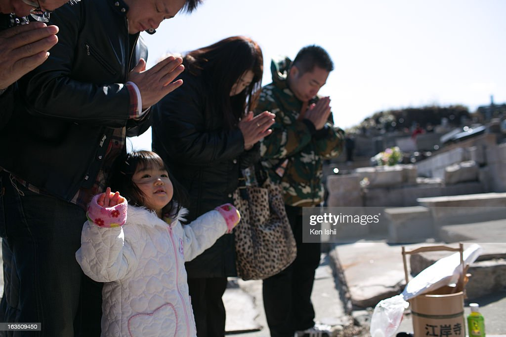 Rei Tanaka, 3, and her family pray for family members who lost their lives in the tsunami two years ago, at Kouganji Temple on March 11, 2013 in Otsuchi, Iwate, Japan. On March 11 Japan commemorates the second anniversary of the magnitude 9.0 earthquake and tsunami that claimed more than 18,000 lives.