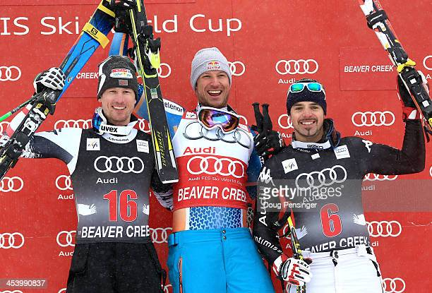 Reichelt Hannes of Austria Aksel Lund Svindal of Norway and Peter Fill of Italy react on the podium after the men's downhill race for the Birds of...