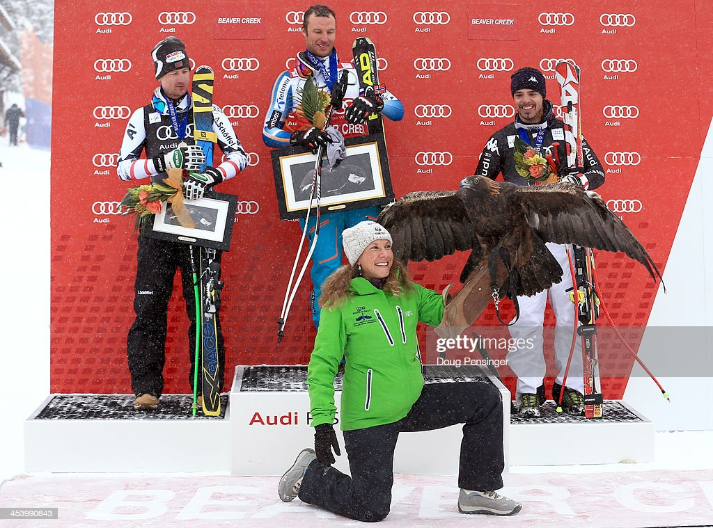 Reichelt Hannes of Austria, <a gi-track='captionPersonalityLinkClicked' href=/galleries/search?phrase=Aksel+Lund+Svindal&family=editorial&specificpeople=227957 ng-click='$event.stopPropagation()'>Aksel Lund Svindal</a> of Norway and <a gi-track='captionPersonalityLinkClicked' href=/galleries/search?phrase=Peter+Fill&family=editorial&specificpeople=4051841 ng-click='$event.stopPropagation()'>Peter Fill</a> of Italy react on the podium after the men's downhill race for the Birds of Prey Audi FIS Ski World Cup on December 6, 2013 in Beaver Creek, Colorado.