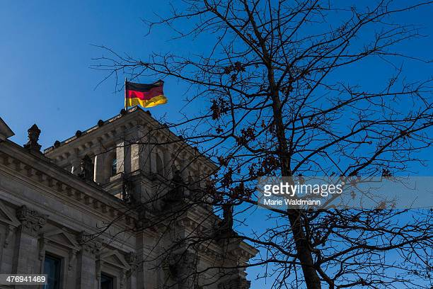 Reichstag building with flag on February 24 2014 in Berlin Germany